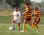 BROOKINGS, SD - AUGUST 23:  McKenzie Wolf #16 from South Dakota State University looks to make a move against Susie Potterveld #3 and Lauren Roeling #11 from Iowa State in the first half of their game Friday evening at Fischback Soccer Field in Brookings. (Photo by Dave Eggen/Inertia)
