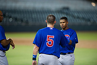 Marcus Mastrobuoni (5) and Nelson Velazquez (20) during a pitching change in Game Three of the Arizona League Championship Series against the AZL Giants on September 7, 2017 at Scottsdale Stadium in Scottsdale, Arizona. AZL Cubs defeated the AZL Giants 13-3 to win the series two games to one. (Zachary Lucy/Four Seam Images)