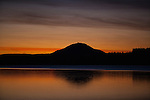 Sunset over Lake Quinault ,  located in glacial carved, Rain Forest  area of the Quinault  Valley in the Southern Olympic mountains area in Washington's Olympic National Park. Lake Quinault  is a year-round destination. In summer, visitors come for views of the Olympic Mountains, fishing, swimming, and as well as for superb hiking. During the winter months Lake Quinault  still offers hiking and fishing. The weather in the Olympic Mountains Rain Forrest is unpredictable, and visitors should be prepared for snow and rain at any time of year.   Jim Bryant Photo. ©2014. All Rights Reserved.