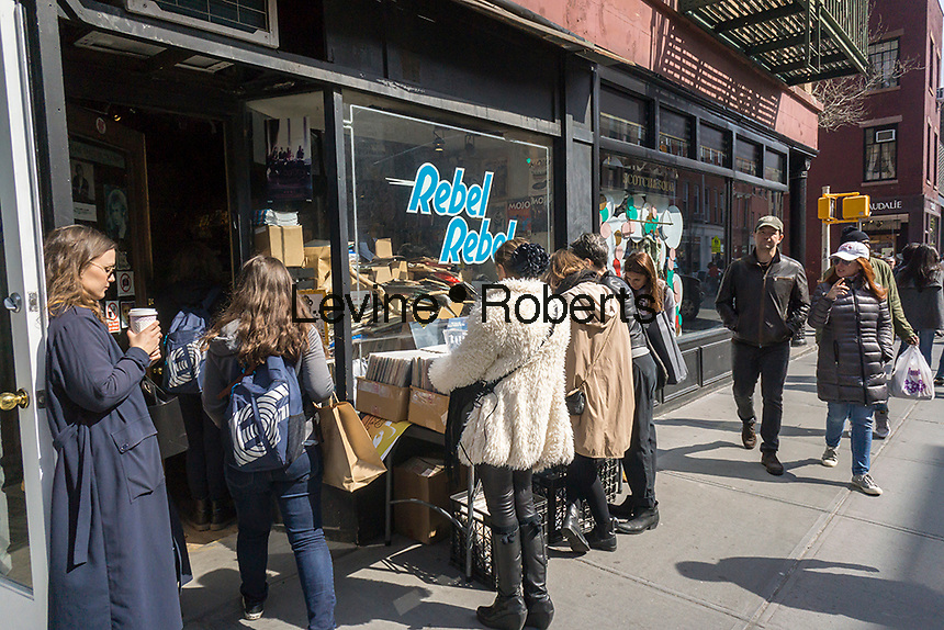 Shoppers  Rebel Rebel records on Bleecker Street in the Greenwich Village neighborhood of New York browsing vinyl records on Sunday, March 27, 2016. The Recording Industry Association of America (RIAA) announced that revenue from vinyl records reached $416 million in 2015 beating the $385 million brought in from streaming services.   (© Richard B. Levine)