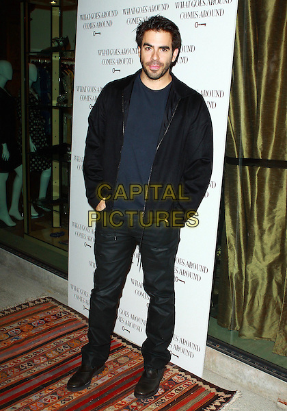 ELI ROTH .WGACA 1 Year Anniversary Party  held at Space15Twenty, Los Angeles, California, USA, 18th March 2010..one arrivals full length black jacket  trousers hands in pockets .CAP/ADM/TC.©T. Conrad/AdMedia/Capital Pictures.