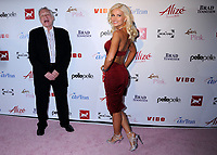 """27 September 2017 - Hugh Marston Hefner aka """"Hef"""" was an American magazine publisher, editor, businessman, and international playboy best known as the editor-in-chief and publisher of Playboy magazine, which he founded in 1953. Hefner was the founder and chief creative officer of Playboy Enterprises, the publishing group that operates the magazine. Hefner was also a political activist and philanthropist. File Photo: 28 August 2008 - Hollywood, California - Hugh Hefner and Holly Madison. Celebrity Catwalk for Charity Benefit for National Animal Rescue at The Highlands Nightclub. Photo Credit: Byron Purvis/AdMedia (Newscom TagID: admphotos321542.jpg) [Photo via Newscom]"""