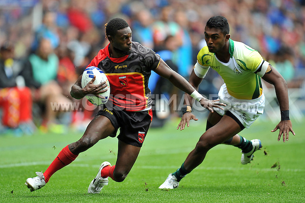 Albert Levi of Papua New Guinea in action in the Men's Rugby Sevens Bowl Quarter-final between Papua New Guinea and Sri Lanka. Day four, Glasgow 2014 Commonwealth Games, Rugby Sevens, on July 27, 2014 at the Ibrox Stadium in Glasgow, Scotland. Photo by: Patrick Khachfe / Onside Images