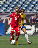 Canadian midfielder Kelly Parker (15) controls the ball as Brazilian defender Rafaelle Sousa (14) shadows. In an international friendly, Canada defeated Brasil, 2-1, at Gillette Stadium on March 24, 2012.