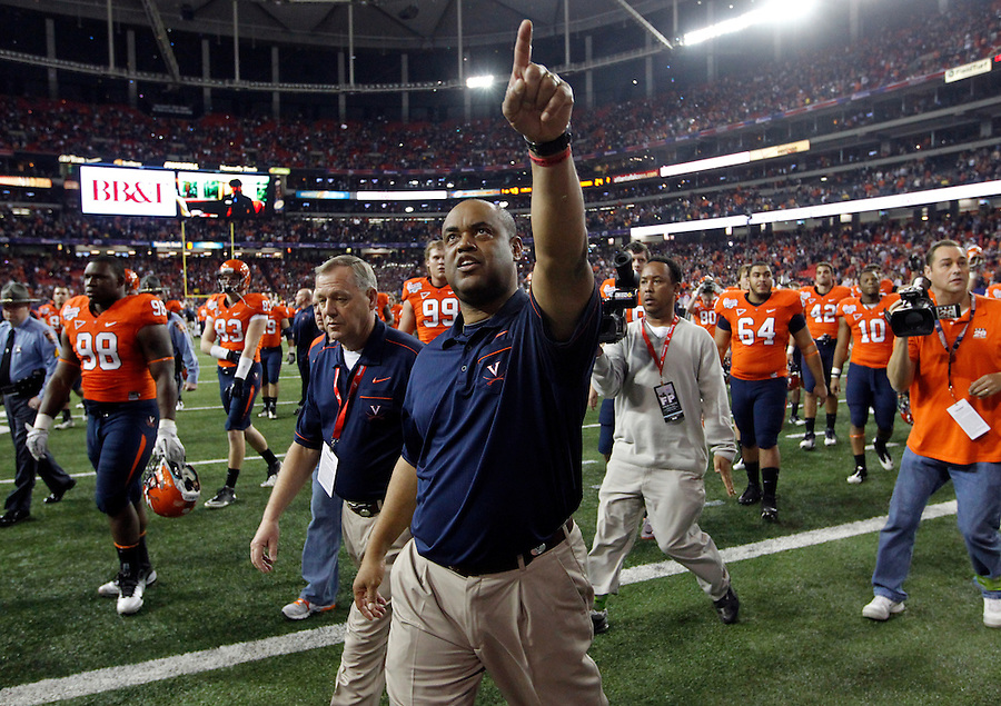 ATLANTA, GA - DECEMBER 31:  Head coach Mike London of the Virginia Cavaliers points to the fans during the 2011 Chick Fil-A Bowl against the Auburn Tigers at the Georgia Dome on December 31, 2011 in Atlanta, Georgia. Auburn defeated Virginia 43-24. (Photo by Andrew Shurtleff/Getty Images) *** Local Caption *** Mike London