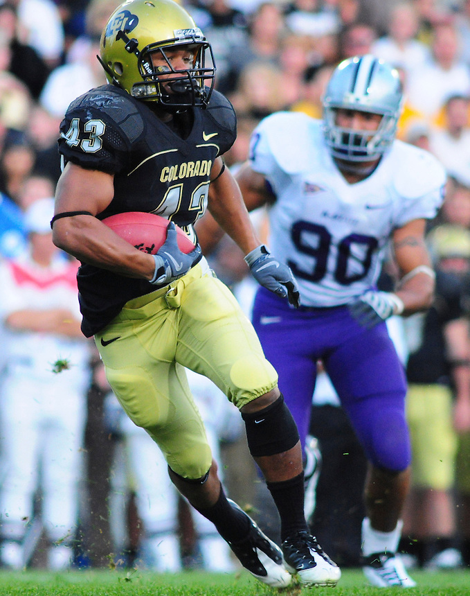 18 October 08: Colorado running back Rodney Stewart (43) rushes against Kansas State. Pursuing Stewart is Kansas State defensive end Eric Childs. The Colorado Buffaloes defeated the Kansas State Wildcats 14-13 at Folsom Field in Boulder, Colorado.