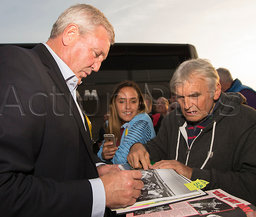 26th September 2017, Pirelli Stadium, Burton upon Trent, England; EFL Championship football, Burton Albion versus Aston Villa; Aston Villa Football Club Manager Steve Bruce signing autographs for supporters outside The Pirelli Stadium before the match
