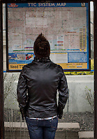 A man looks at a TTC system map in Toronto April 25, 2010. The Toronto Transit Commission (TTC) is a public transport authority that operates buses, streetcars, subways, and rapid transit lines in Toronto.