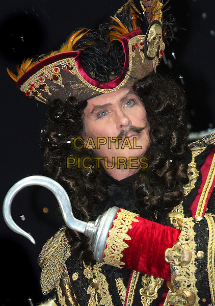 DAVID HASSELHOFF.First Family Entertainment 2011 Pantomimes Photocall at the Piccadilly Theatre, London, November 26th 2010..panto costume portrait headshot  captain hook gold wig jacket hat moustache mustache pirate hat feathers gold brocade jacket .CAP/JIL.©Jill Mayhew/Capital Pictures