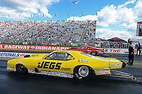 Sept 9, 2012; Clermont, IN, USA: NHRA pro mod driver Troy Coughlin (near lane) races alongside Todd Tutterow during the US Nationals at Lucas Oil Raceway. Mandatory Credit: Mark J. Rebilas-