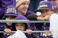 Young Husky fans feel the tension in a close game.