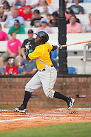 Carlos Ozuna (3) of the Bristol Pirates follows through on his swing against the Johnson City Cardinals at Howard Johnson Field at Cardinal Park on July 6, 2015 in Johnson City, Tennessee.  The Cardinals defeated the Pirates 8-2 in game two of a double-header. (Brian Westerholt/Four Seam Images)