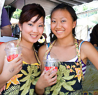 Beautiful Hmong teenage food servers holding fruit punch drinks. Hmong Sports Festival McMurray Field St Paul Minnesota USA