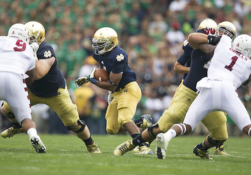 August 31, 2013:  Notre Dame Fighting Irish running back George Atkinson III (4) runs for yardage during NCAA Football game action between the Notre Dame Fighting Irish and the Temple Owls at Notre Dame Stadium in South Bend, Indiana.  Notre Dame defeated Temple 28-6.
