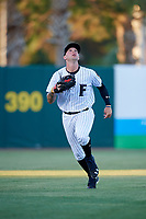Florida Fire Frogs left fielder Braxton Davidson (24) tracks a fly ball during a game against the Dunedin Blue Jays on April 10, 2017 at Osceola County Stadium in Kissimmee, Florida.  Florida defeated Dunedin 4-0.  (Mike Janes/Four Seam Images)
