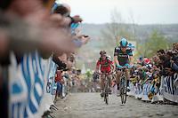 Bernie Eisel (AUT/SKY) &amp; Manuel Quinziato (ITA/BMC) over the Oude Kwaremont<br /> <br /> Ronde van Vlaanderen 2014