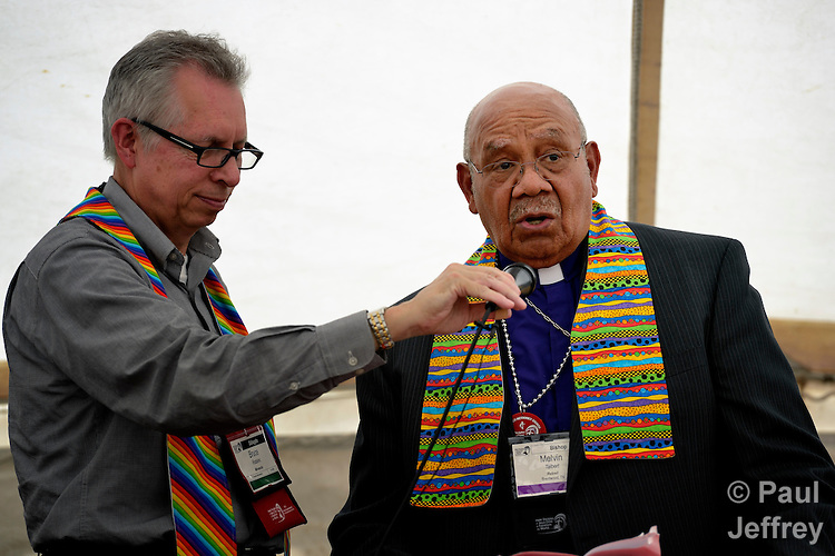 Bishop Melvin Talbert (right) joined 13 other United Methodist bishops at a gathering on May 4 outside the 2012 United Methodist General Conference in Tampa, Florida, where they showed their support for clergy in the denomination who choose to officiate at religious weddings of same-sex couples. Doing so is a violation of church rules, but Talbert said he preferred Biblical obedience even if it meant ecclesiasical disobedience. Holding the microphone for Talbert is the Rev. Bruce Robbins, pastor of the Hennepin Avenue United Methodist Church in Minneapolis. Robbins is among those who has vowed to marry any same-sex couples who come to him prepared for marriage.