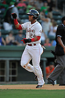 Second baseman Yoan Moncada (24) of the Greenville Drive in a game against the Greensboro Grasshoppers on Tuesday, August 25, 2015, at Fluor Field at the West End in Greenville, South Carolina. The Cuban-born 19-year-old Red Sox signee has been ranked the No. 1 international prospect in baseball by Baseball America. Greensboro won, 3-2. (Tom Priddy/Four Seam Images)