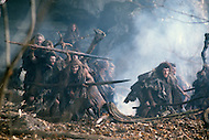 "Toronto area, Canada.1981. 80,000 years ago, the tribe who posessed fire, posessed life. A primitive tribe try to keep a natural fire source for survival.  This part of the movie was filmed in Canada.  ""Quest for Fire"" (La guerre du feu) by French director Jean-Jacques Annaud, and based on the novel of JH Rosny. Scene of the tribe under attack, trying to keep their fire."