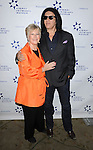 Gene Simmons and Margaret Loesch at the '13th Annual Discovery Award Dinner' held at the Beverly Hills Hotel November 14, 2013