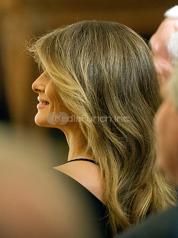 Melanie Trump looks on as United States President Donald J. Trump makes remarks at a reception for US Senators and their spouses in the East Room of the White House in Washington, DC on Tuesday, March 28, 2017.<br /> Credit: Ron Sachs / Pool via CNP /MediaPunch