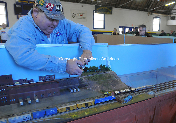 TORRINGTON, CT-12 DECEMBER 2009-121209IP04-Ed Pasko of Torrington takes a photo of a rare model train wreck at the Torrington Area Model Railroaders show at the Torrington Armory on Saturday.<br /> Irena Pastorello Republican-American