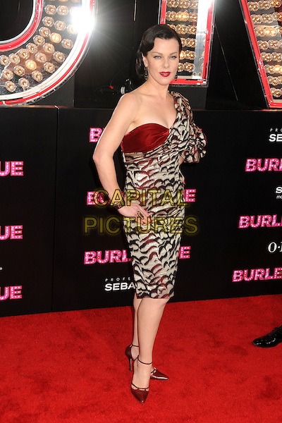 "DEBI MAZAR .""Burlesque"" Los Angeles Premiere held at Grauman's Chinese Theatre, Hollywood, California, USA, .15th November 2010..full length hands on hips red gold one sleeve shoulder print ankle strap pointy shoes .CAP/ADM/BP.©Byron Purvis/AdMedia/Capital Pictures."