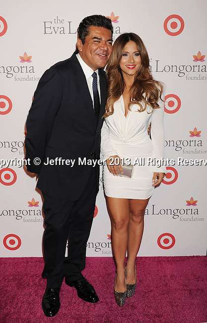 HOLLYWOOD, CA- SEPTEMBER 28: Actor George Lopez and Jackie Guerrido arrive at the Eva Longoria Foundation Dinner at Beso restaurant on September 28, 2013 in Hollywood, California.