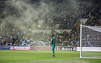 Goalkeeper Reice Charles-Cook of Coventry City stands as a flair hangs in the air during the The Checkatrade Trophy - EFL Trophy Semi Final match between Coventry City and Wycombe Wanderers at the Ricoh Arena, Coventry, England on 7 February 2017. Photo by Andy Rowland.