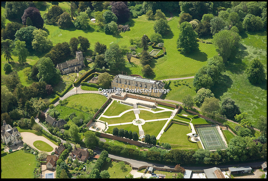 BNPS.co.uk (01202 558833)<br /> Pic: Phil Yeomans/BNPS<br /> <br /> Re-buy my shire...<br /> <br /> Pop star Robbie Williams is so desperate to sell his country mansion home that he is prepared to write off £2.6 million pounds to get rid of it.<br /> <br /> The Take That singer bought sprawling Compton Bassett House in Wiltshire on a whim in 2009 for £8.1 million pounds.<br /> <br /> But shortly after buying it he realised he wanted to return to Los Angeles with his wife, Ayda Field, and tried to sell it in 2010 for £7.5 million pounds.<br /> <br /> But the mansion failed to sell and Robbie has been left with no choice but to lower the asking price for a second time.<br /> <br /> The 70 acre property contains a 7 bedroom mansion, extensive gardens, full sized football pitch, go-cart track, gymnasium, tennis court and a 5-a-side football pitch.