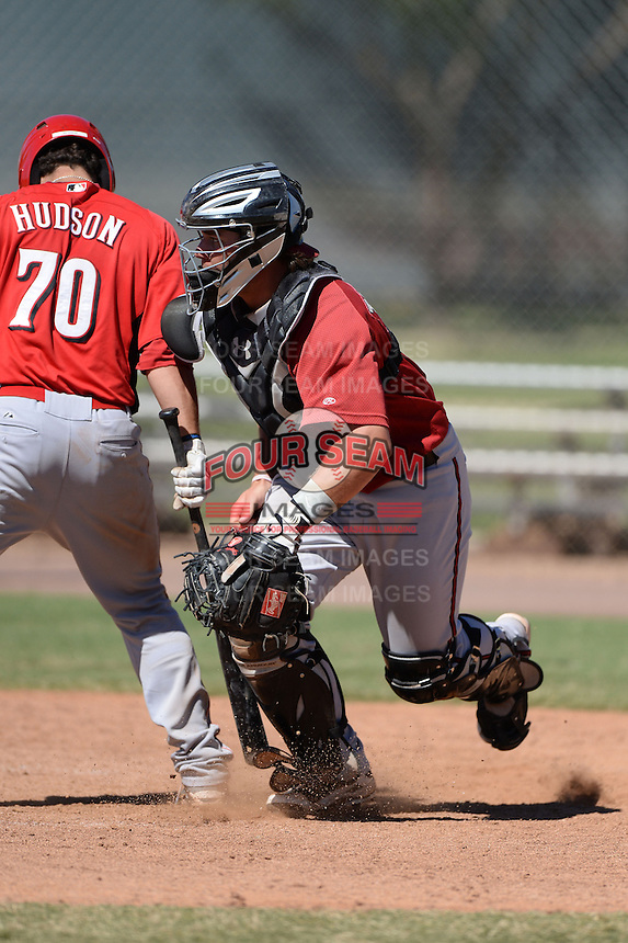 Arizona Diamondbacks catcher Stryker Trahan (34) tracks down a blocked ball during an Instructional League game against the Cincinnati Reds on October 5, 2013 at Salt River Fields at Talking Stick in Scottsdale, Arizona.  (Mike Janes/Four Seam Images)