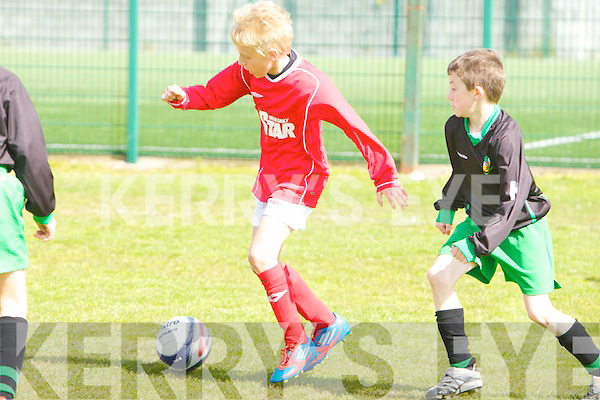 St Brendan's Park Sebiastan Vasiu and Kingdom Boys Darren Leen in action in the U11 Kerry Cup semi-final at Christy Leahy park, Tralee on Saturday.