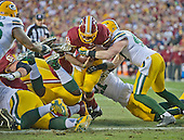 Washington Redskins running back Alfred Morris (46) is stopped near the goal line by Green Bay Packers inside linebacker Jake Ryan (47) in first quarter action during an NFC Wild Card game at FedEx Field in Landover, Maryland on Sunday, January 10, 2016.  The Packers won the game 35 - 18.<br /> Credit: Ron Sachs / CNP