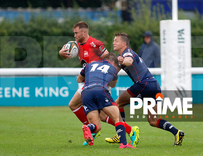 Ben Robbins of London Scottish makes the tackle during the Greene King IPA Championship match between London Scottish Football Club and London Welsh RFC at Richmond Athletic Ground, Richmond, United Kingdom on 10 September 2016. Photo by Carlton Myrie / PRiME Media Images.