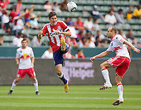 NY RedBulls midfielder Joel Lindpere (20)and Chivas USA midfielder Sacha Kljestan (16) battle in the midfield. Chivas USA defeated the Red Bulls of New York 2-0 at Home Depot Center stadium in Carson, California April 10, 2010.  .