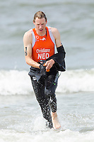 13 JUL 2013 - DEN HAAG, NED - Joost Christiaans (NED) of the Netherlands heads for transition at the end of the swim at the 2013 ITU Elite Men's Cross Triathlon World Championships  in Kijkduin, Den Haag (The Hague), the Netherlands (PHOTO COPYRIGHT © 2013 NIGEL FARROW, ALL RIGHTS RESERVED)