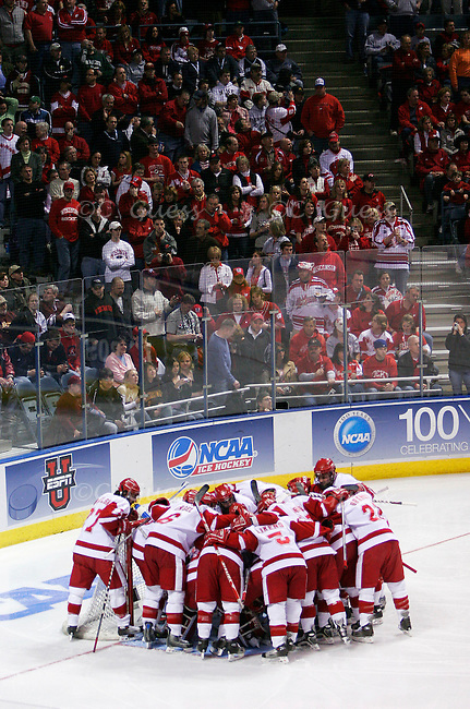 The University of Wisconsin-Madison 2005-2006 men's hockey team plays Boston College in the final game of the NCAA championship tournament held at the Bradley Center in Milwaukee, Wis. on Apr. 8, 2006.  The Badgers would go on to win the game and the championship 2-1...The Badgers huddle around the goal just before the face off to start the game. Since the game was held only one hour away from the team's hometown of Madison the stand were essentially a giant sea of red, with hardly any Boston maroon to be seen.