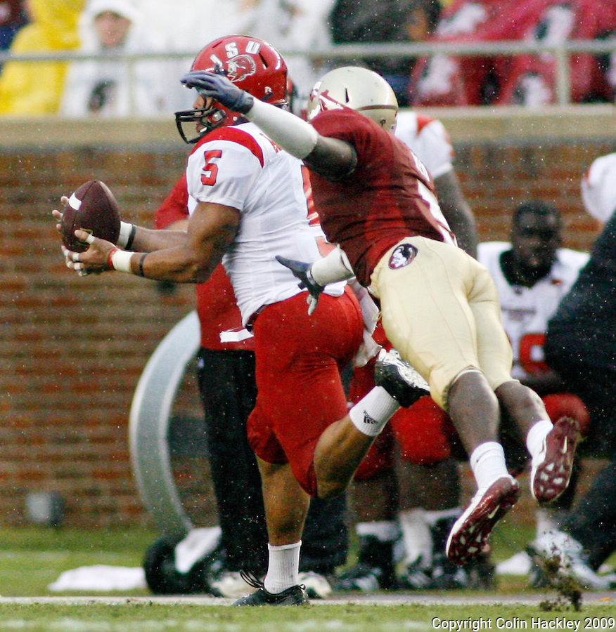 TALLAHASSEE, FL 9/12/09-FSU-JSUFB09 CH19-Florida State's Justin Bright can't keep Jacksonville State's James Wilkerson from pulling in a long pass during first half action Saturday at Doak Campbell Stadium in Tallahassee. .COLIN HACKLEY PHOTO