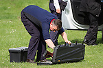 "© Joel Goodman - 07973 332324 . Stockport , UK . Veterinary surgeon SIMON CONSTABLE places his tranquiliser gun back in its case .A wild deer which was discovered in a park by the busy Manchester Road in Stockport has been rescued after three days . The park was closed and locked by Stockport Council officials on Monday 24th June after the young male started bolting across the playing field and playground and butting its head and antlers against railings . But with the gates locked , the young animal could not escape . For three days local people came out to watch the deer from the fence as it hid in bushes around the edge of the park , occasionally venturing out across the playing pitch and in the direction of the busy A626 road . The landlord at "" The Hind's Head "" pub opposite , Stuart Kirkham , a Manchester United fan , named the beast "" Ronaldo "" because of its red colouring . After three days , with no hope of escape under its own steam and with the park still closed , the RSPCA and council brought in a veterinary surgeon to help . The animal was tranquilised and driven to nearby Reddish Vale Country Park , where he was brought round and released back in to the wild . Photo credit : Joel Goodman"