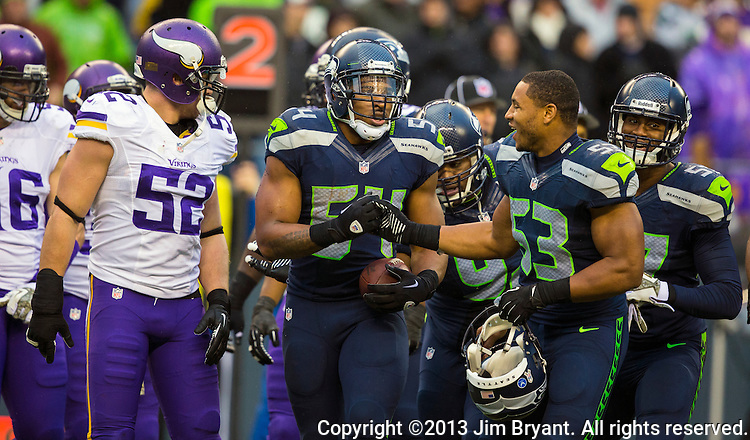 Seattle Seahawks  linebacker Bobby Wagner (54) celebrates a pass interception with teammate Malcolm Smith (53) against the Minnesota Vikings  at CenturyLink Field in Seattle, Washington on  November 17, 2013.  The Seahawks beat the Vikings 41-20.  ©2013.  Jim Bryant. All Rights Reserved.