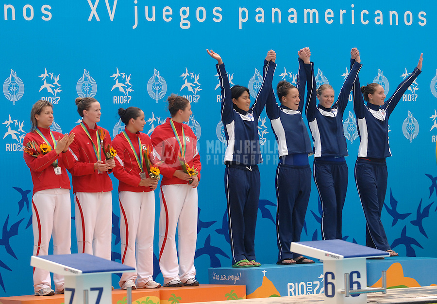 Jul 18, 2007; Rio de Janeiro, Brazil; The silver medal winning Canadian team looks on as the United States team celebrates after winning the gold medal in the womens 4 x 200m freestyle during the Pan American Games at the Rio Aquatic Park in Rio de Janeiro. Mandatory Credit: Mark J. Rebilas-US PRESSWIRE Copyright © 2007 Mark J. Rebilas