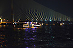 Cruising on the Chao Phraya by the King Rama VIII bridge in Bangkok in Thailand.