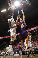Jan. 2, 2011; Charlottesville, VA, USA; /v5 prepares to block the shot of LSU Tigers forward Matt Derenbecker (21) during the game at the John Paul Jones Arena. Virginia won 64-50. Mandatory Credit: Andrew Shurtleff-