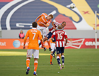 CARSON, CA  March 11, 2012: Houston Dynamo defender Andre Hainault (31) and Chivas USA midfielder Peter Vagenas (6) during the match between Chivas USA and Houston Dynamo at the Home Depot Center in Carson, California. Final score Chivas USA 0, Houston Dynamo 1.