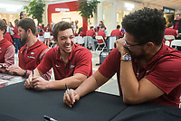 NWA Democrat-Gazette/BEN GOFF @NWABENGOFF<br /> Dominic Fletcher (left), Arkansas outfielder, and right-hand pitcher Isaiah Campbell have a laugh while signing autographs for fans Saturday, Feb. 9, 2019, during Arkansas baseball's annual Meet the Razorbacks Day at Northwest Arkansas Mall in Fayetteville.