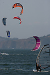Wind and kite board sailing shared the same wind off the coast of Crissy Field in the Presido as the weather and the wind was perfect on the bay in San Francisco, California.