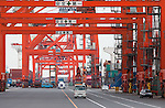 April 20, 2011, Tokyo, Japan - A slow pace of work is seen at a shipping terminal at the port in Tokyo. Japan's exports fell more quickly than expected in March since the March 11 earthquake and tsunami that hit the northeast region of Japan, later causing a nuclear crisis that Japan is still continuing to battle. According to economists, the rapid decline in exports is a sign that shipments will continue to weaken and hurt economic growth. Exports declined 2.2 percent in March from a year earlier. (Photo by Christopher Jue/AFLO) [2331]