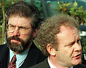 Sinn Fein's President Gerry Adams listens to Martin McGuinness as he answers media questions at Stormont Castle Buildings, Belfast, Northern Ireland, Thursday, April 9 1998,  as the talks began to face this  todays important deadline. (AP Photo/Paul McErlane)