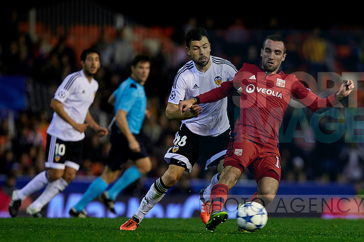 Sergio Darder (R) of Olympique Lyonnais competes for the ball with Javi Fuego of Valencia CF  - UEFA Champions League Group H - Valencia CF vs Olympique Lyonnais - Mestalla Stadium - Valencia- Spain - 09th December 2015 - Pic David Aliaga/Sportimage