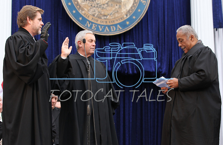 Nevada Supreme Court Justices Ron Parraguirre, left, and James W. Hardesty take the oath of office from Chief Justice Michael Douglas during Monday's inauguration, Jan. 3, 2011 at the Capitol in Carson City, Nev. <br /> Photo by Cathleen Allison
